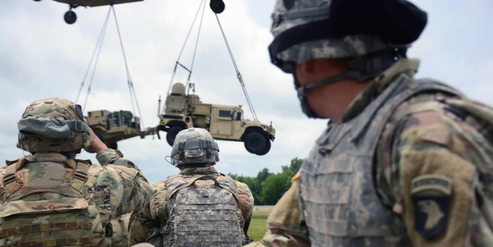 Figure 5: A CH-47 sling loads a Humvee equipped with WIN-T. GD Mission Systems' TCN-Lite version further reduces the larger, stationary portions of WIN-T to mobile platforms. (Courtesy: General Dynamics Mission Systems; U.S. Army photo by Sgt. Bradford Alex.)